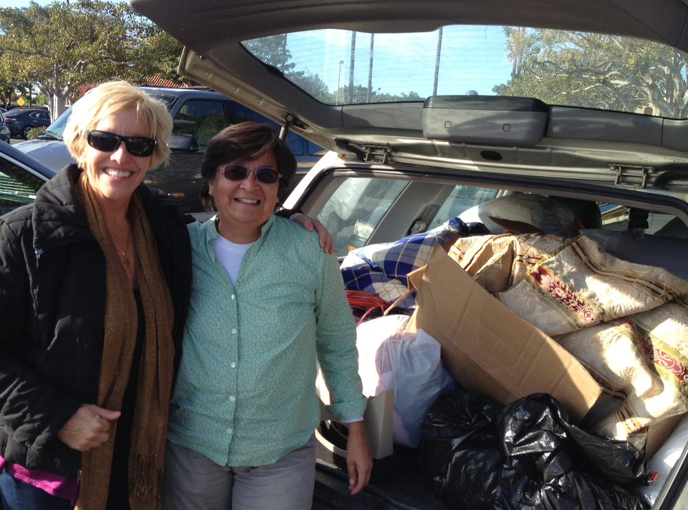 Peggy Hall and Alicia Harvey loading up one of many carloads of generous donations of blankets, towels, sheets, pet beds, food, toys, leashes and medicine bound for Mexico