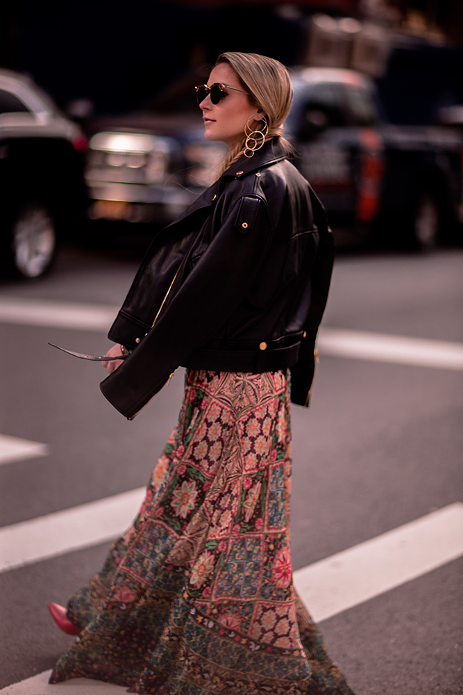 Christie Ferrari wearing Alice + Olivia two piece set with black leather jacket maxi skirt