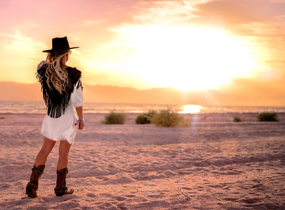 Christie Ferrari Coachella Outfit with Storets dress, Nasty Gal vest and DSW Boots.