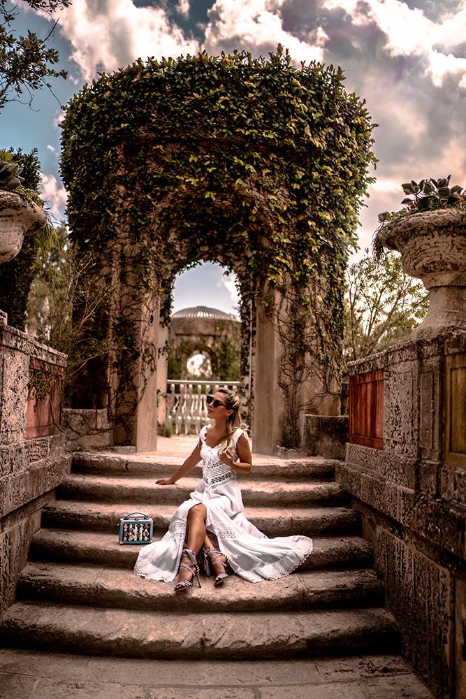 Christie Ferrari wears white summer dress with nautical accessories at vizcaya gardens in miami.