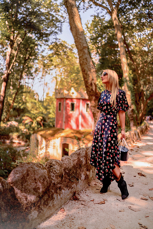 Christie Ferrari wears dark floral dress from MILLY in Portugal, for Fall Fashion Trends 2018 special feature on dark florals.