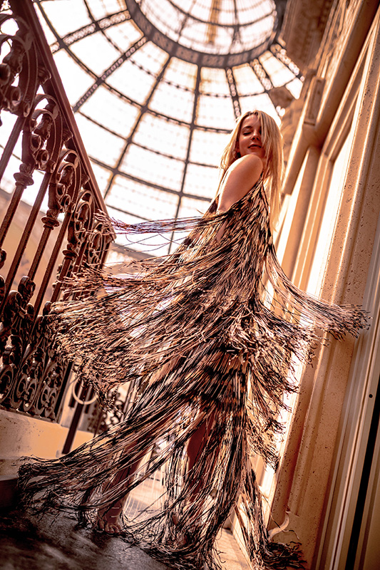 Christie Ferrari twirling in a Missoni dress in Milan as part of a Holiday Dress Shopping Guide
