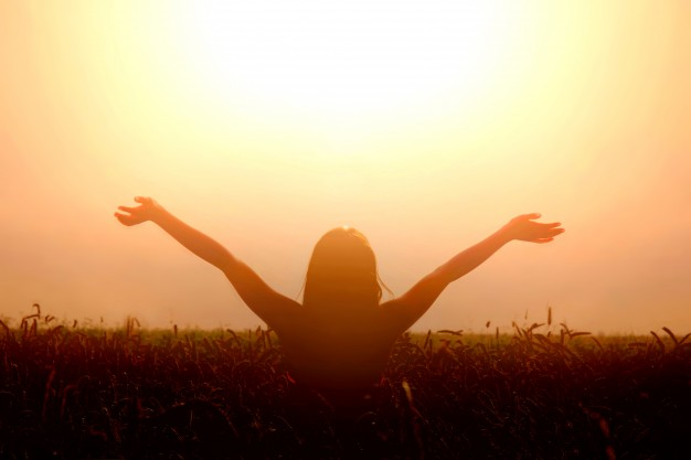 girl-lift-her-hands-to-the-sky-and-feel-freedom_1204-253.jpg
