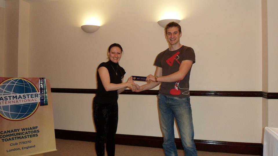 Sergei being awarded the Best Speaker ribbon by Ellie