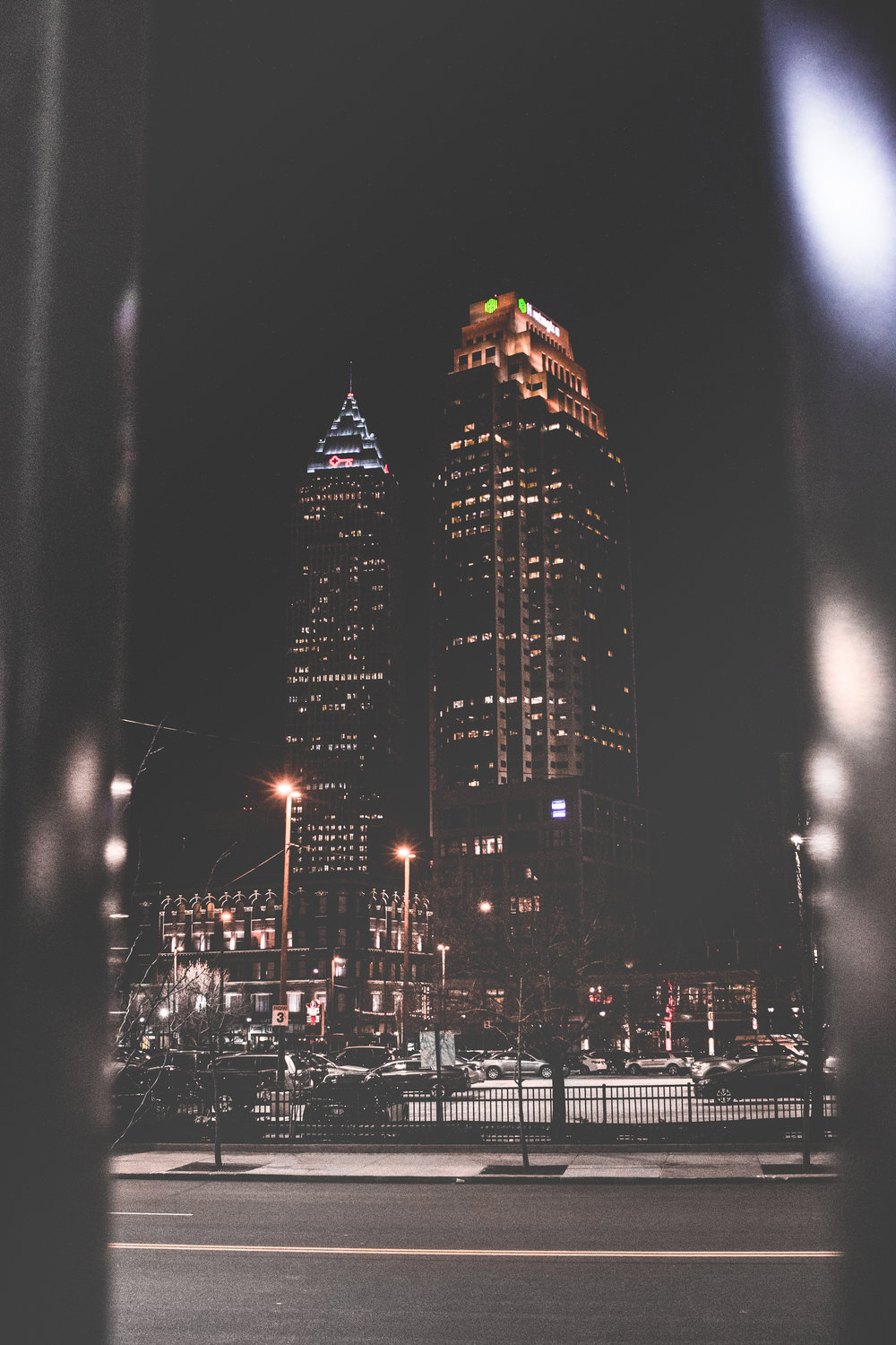 Cleveland has some dope views. - I wasn't that excited about shooting in Cleveland to be honest. It was a cold and super windy night as well which made me rethink my choices. I had three hours to kill alone and being alone on the streets actually made me focus way more on the little details. Finding vantage points like this one makes on alright photo of these buildings more interesting and creates depth.