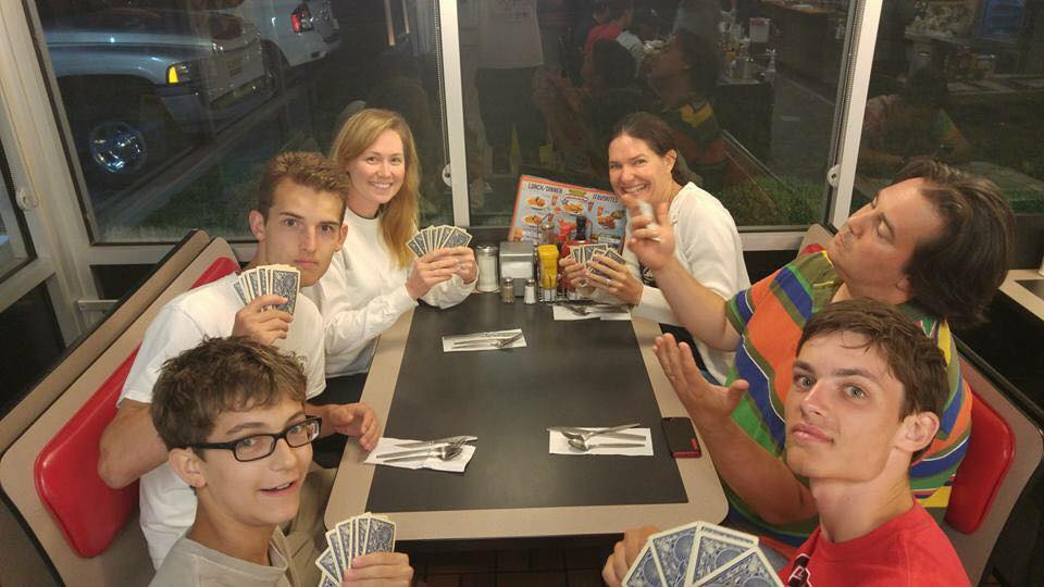 Stewart (second from right) playing a late night game of cards with a late night meal at Waffle House on the Youth Mission Trip to Tennessee this summer.