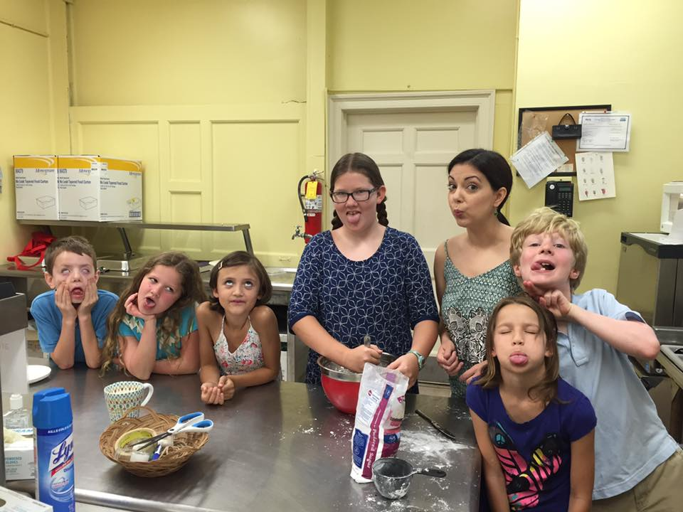 Tiffania (third from right) trying to teach Sunday Schoolers a thing or two about cooking.