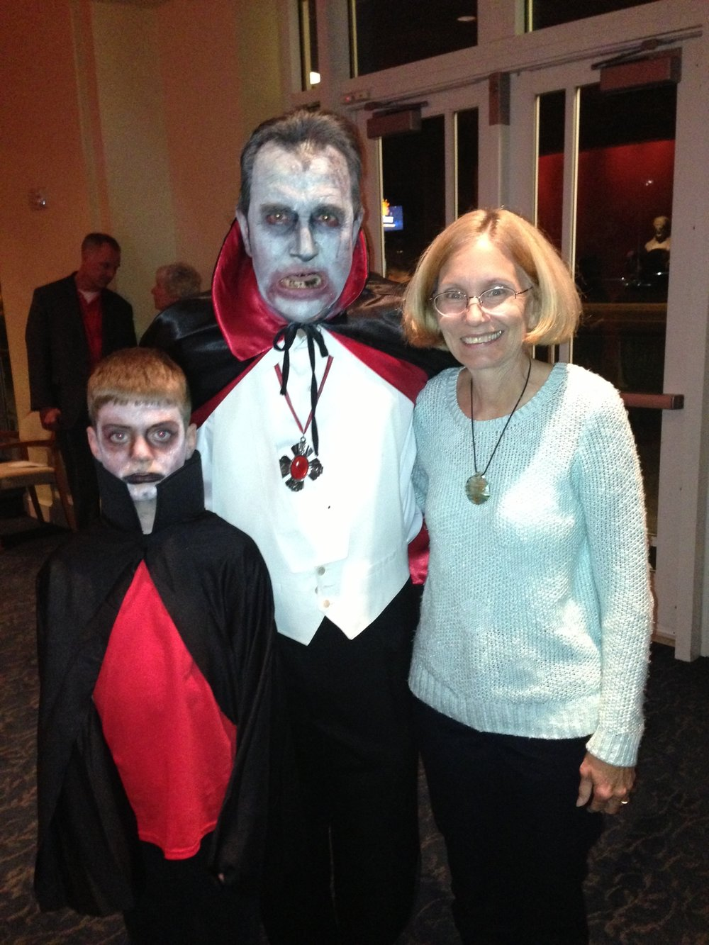Kenny and Timothy pictured with Glenn member Barbara McClure at Scary Ride.