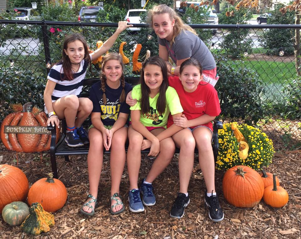 Glenn Youth helping to unload the pumpkins and beautify the patch.