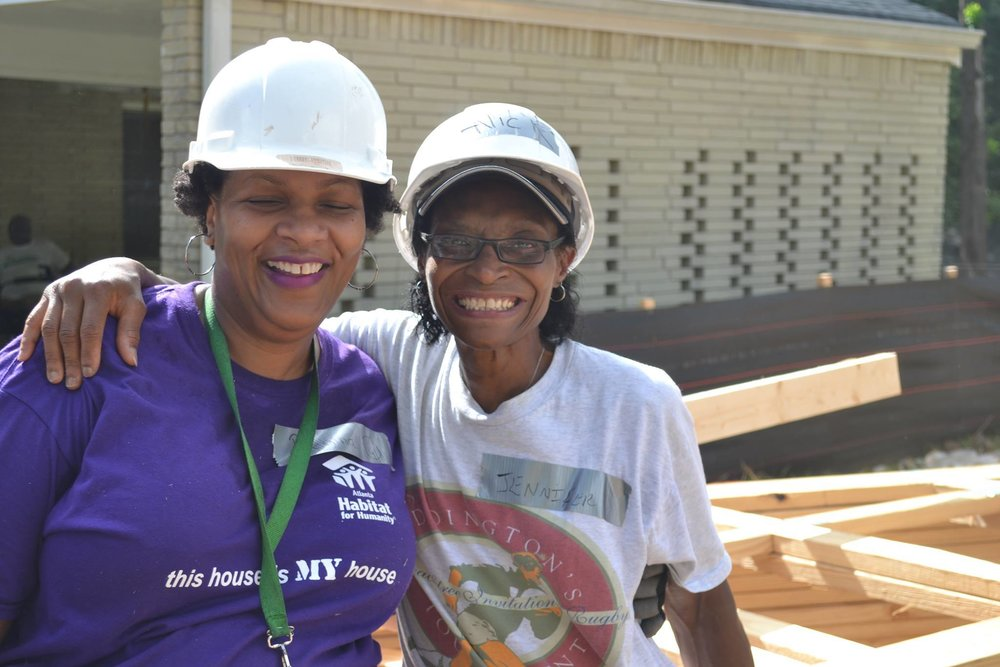 This year was our 25th Habitat Build! Our devoted project liaison, Jennifer Scott-Ward, hugs home owner Regina Holloway after a busy build day.