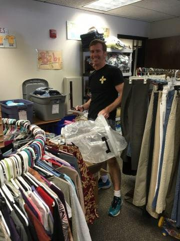 Aaron volunteering at the IRC refugee store.