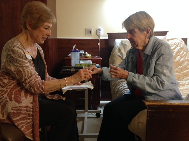 Carolyn (left) and Linda (right) serving communion to one another.