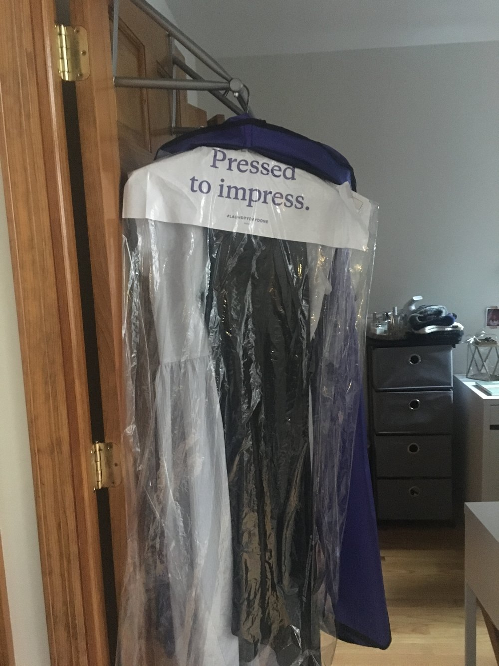 My beautiful dry cleaning featuring their purple bag!