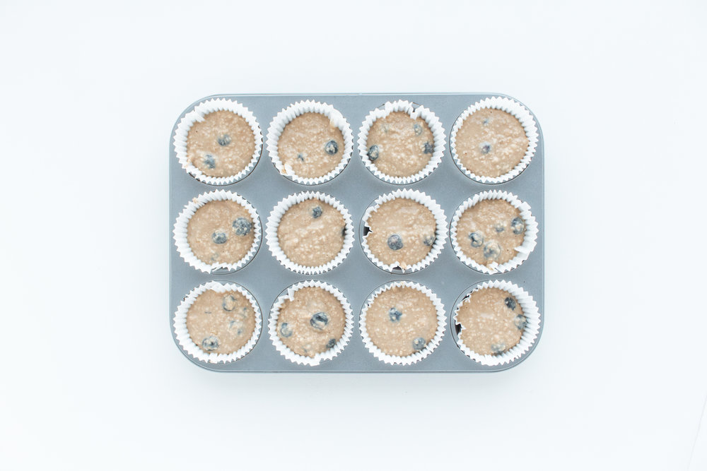 - Spoon into the muffin tin and bake for 22-24 minutes.