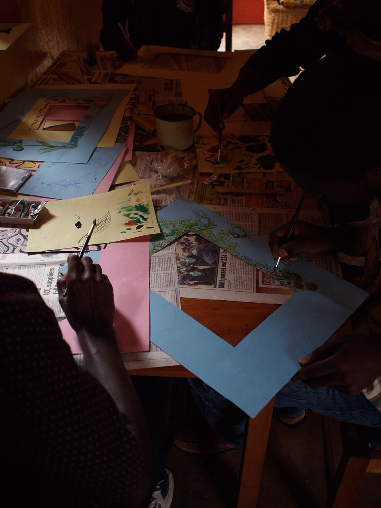 Preparing artworks for Kabale Home Project exhibition