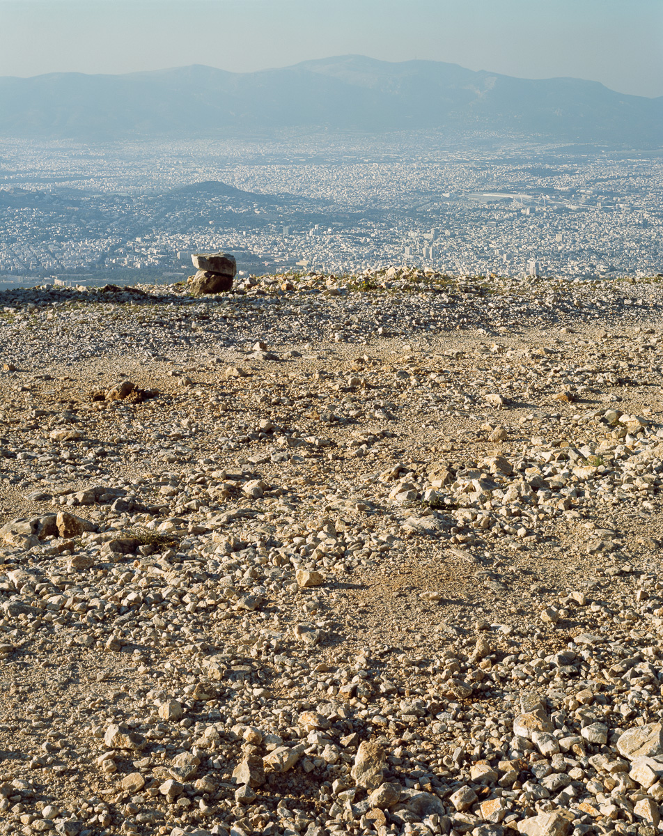 Just below the summit of Mt. Hymettus at approximately 1,000 meters.  The summit is inaccessible due to a transmitter park for several major TV and radio stations, along with military radar.  View looking west from Mt. Hymettus with Mt. Parnitha in the background.