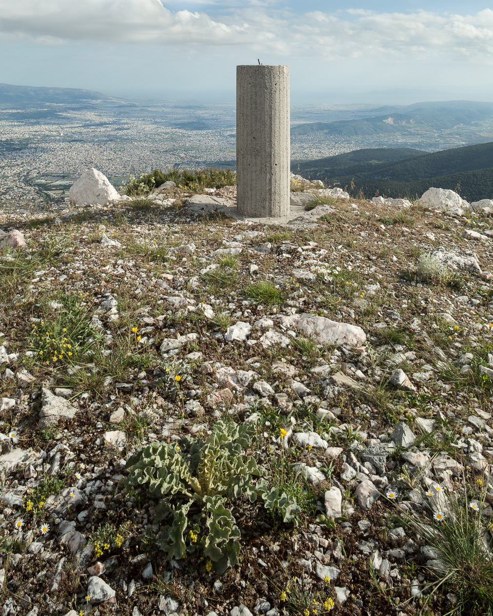 "At the summit of Greek mountains one will almost always find the ""kolonaki"" or little column, built by the Greek military and used as triangulation points for topographical surveys. View looking southeast from the summit of Mt. Parnitha at approximately 1,400 meters."