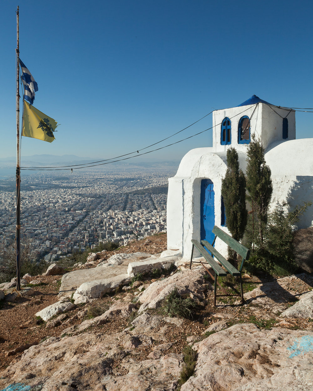 "The church of Profitis Ilias on the southern slopes of Mt. Hymettus. A typical ""exoklisi,"" or outer church, in the architectural style derived from Greece's Cycladic islands. ""Exoklisia"" are commonly found in more remote areas around Greece and used on special occasions and feast days. View facing northwest."