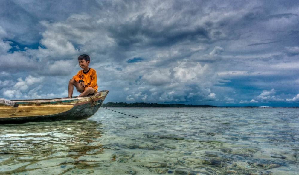 local indonesia culture fishing adventure surf vacation