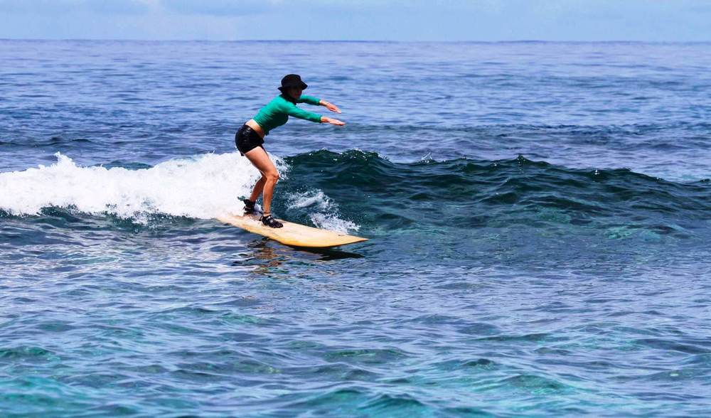 Learn to surf longboard easy waves samoa