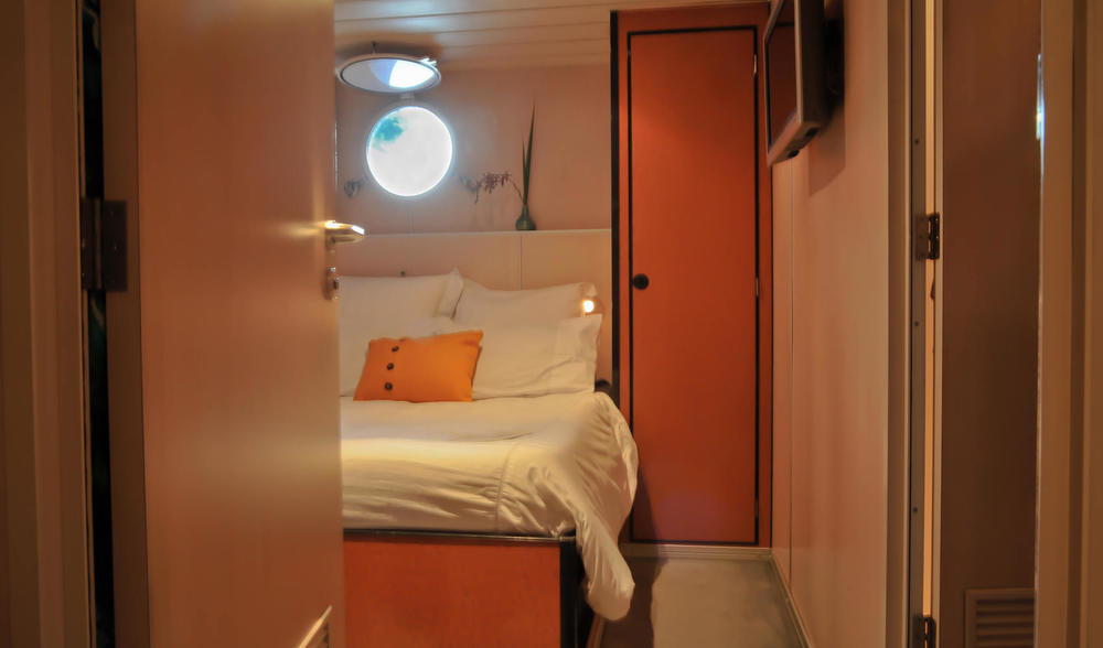 sleep and stay in comfort at the Ratu Motu while cruising in West Papua and West Sumatra