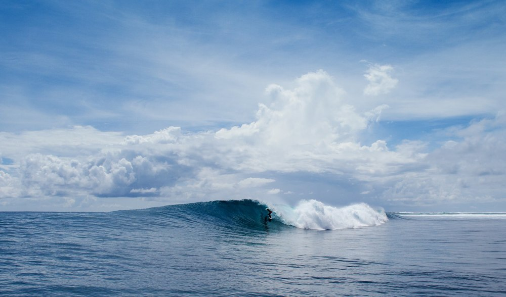 Experienced surfing guides aboard a small vessel from Pegasus Lodges and Resorts in West Sumatra