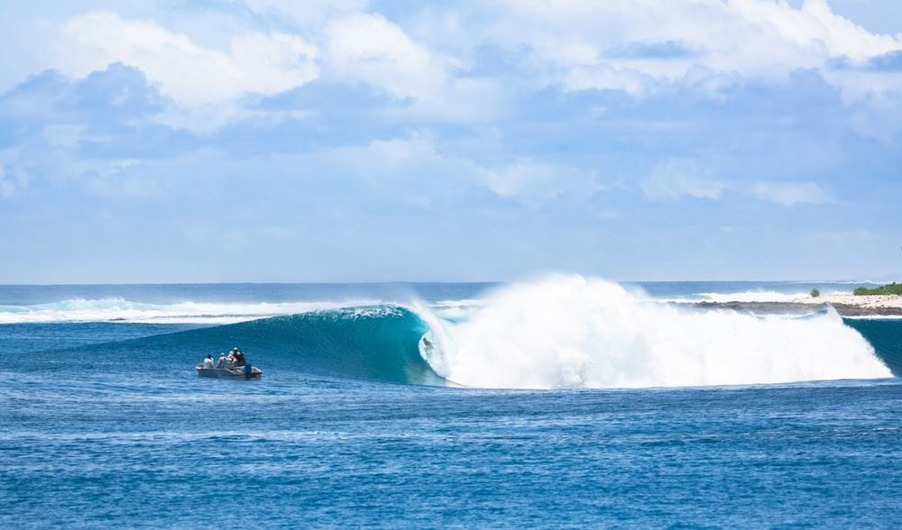 a man enjoying surf opportunities aboard the ratu motu