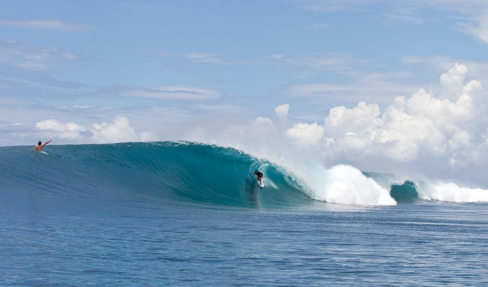 a surfer ducking under a perfect left-handed barrel, pegasus lodges and resorts