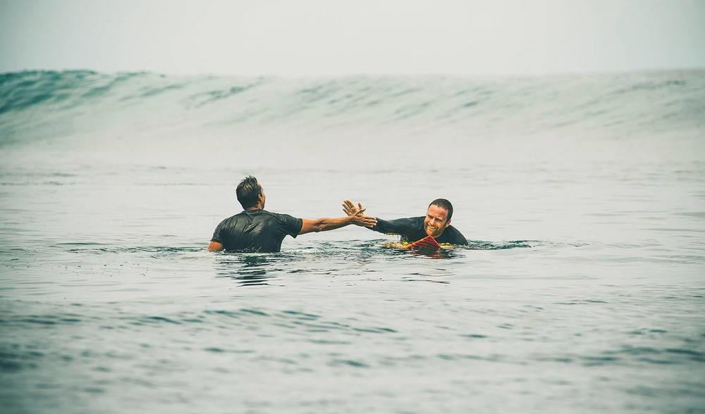 two mates, guests at pegasus lodges and resorts, enjoying some indonesia surf to themselves