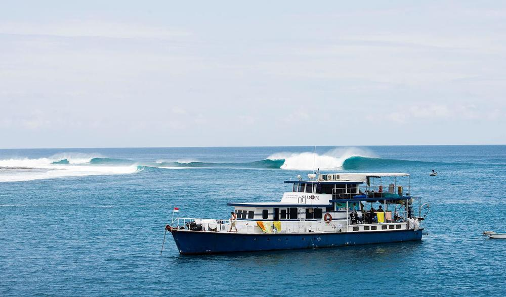 a small boat observed by Pegasus guests aboard the ratu motu