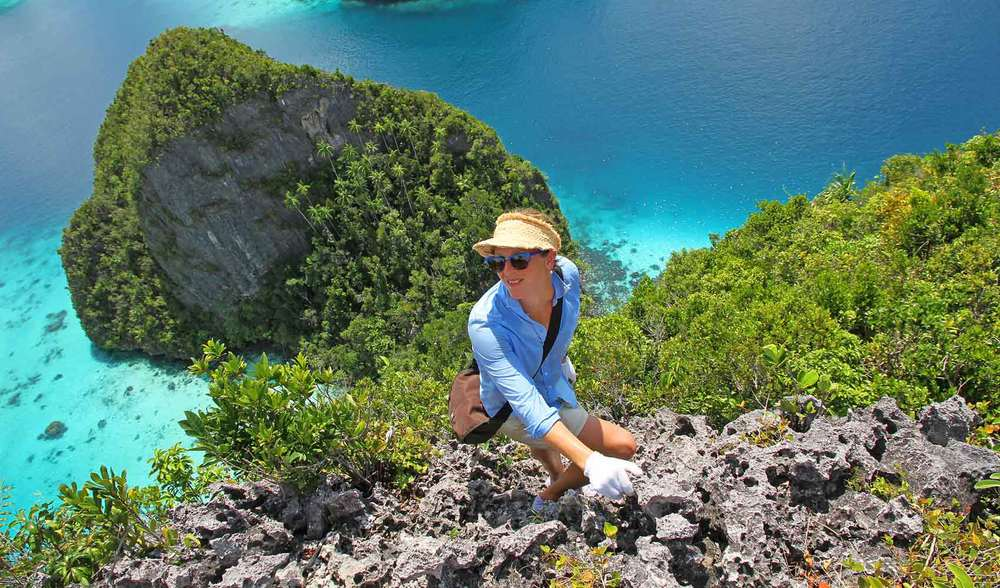 a Pegasus guest rock climbing one of the many islands near indonesia