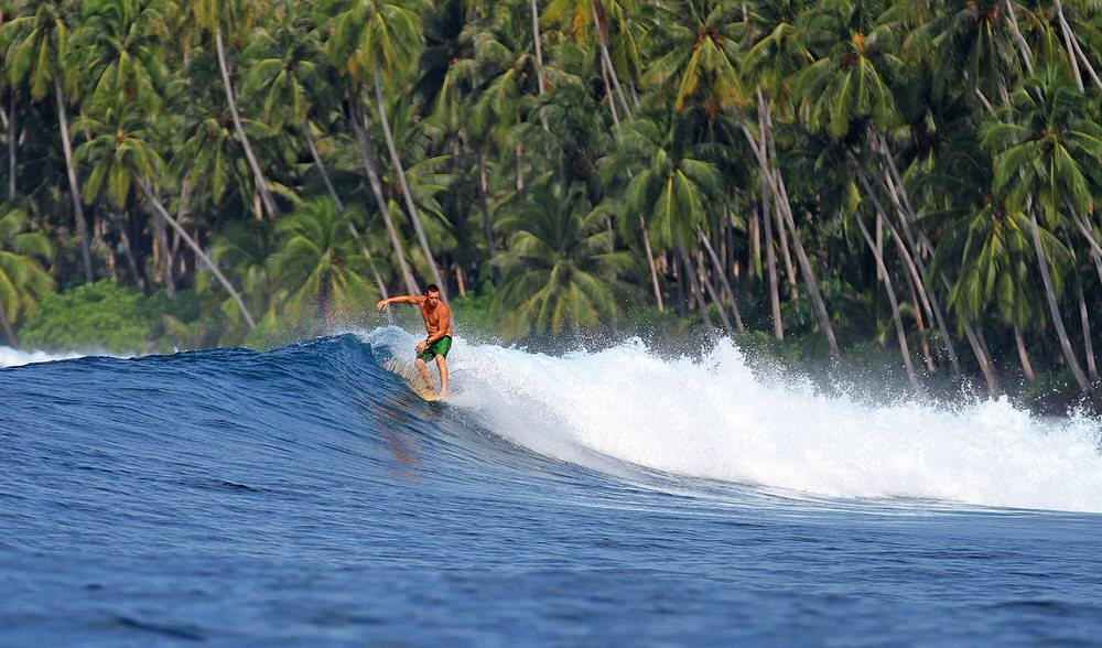 Surfing indonesia long board stand up paddle surf guides luxury surf travel vacation