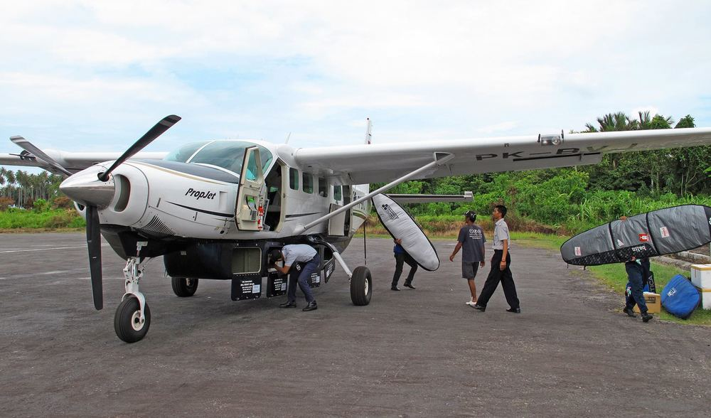 Private charter plane telo island lodge indonesia surf trip