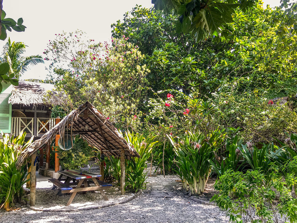 A view of the lodging and open air dining spot in Bruno's lush garden, Pegasus Lodges.jpg