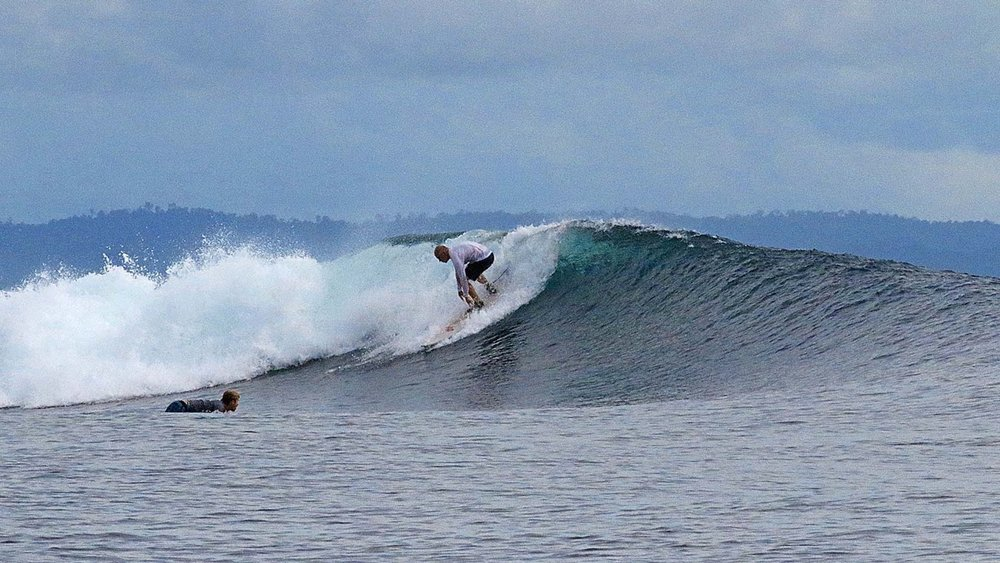 Aleks dropping into a glassy one.
