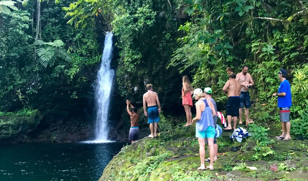Group dip at the waterfall, 10 minutes from the lodge.