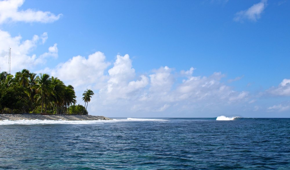 A small left peels down the Fanning reef.