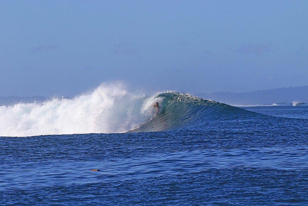 Kev body surfing.
