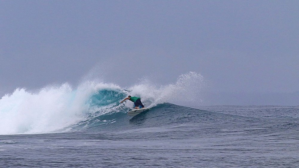 Kerwin carving back to the foam.