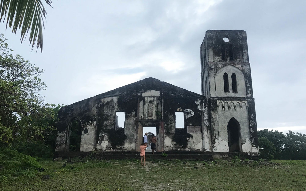 Island tour, featuring the old church ruins.