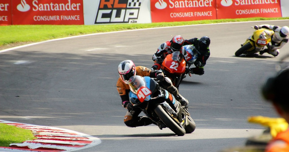 Race 1: closely followed by #22 Dave Mackay, #44 Alastair Fagan, #28 Ben Broadway. Photo by  Janet's Photo Page