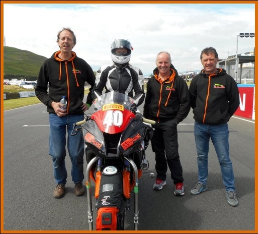 Nadieh on the grid at Knockhill with her dad Alex, Team ILR owner/manager Ian Lougher, and team mechanic Matt Jackson.