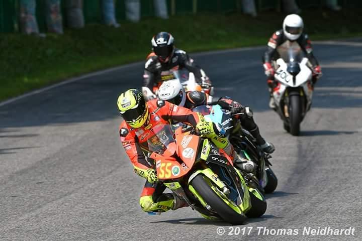 Close racing with David Datzer (#55). Photo by Thomas Neidhardt.