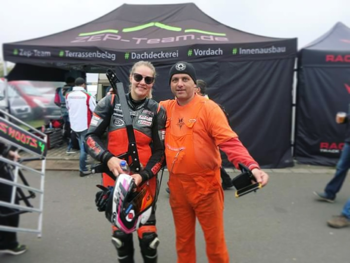 With Tomas Bata and his Dutch/orange outfit in the paddock.