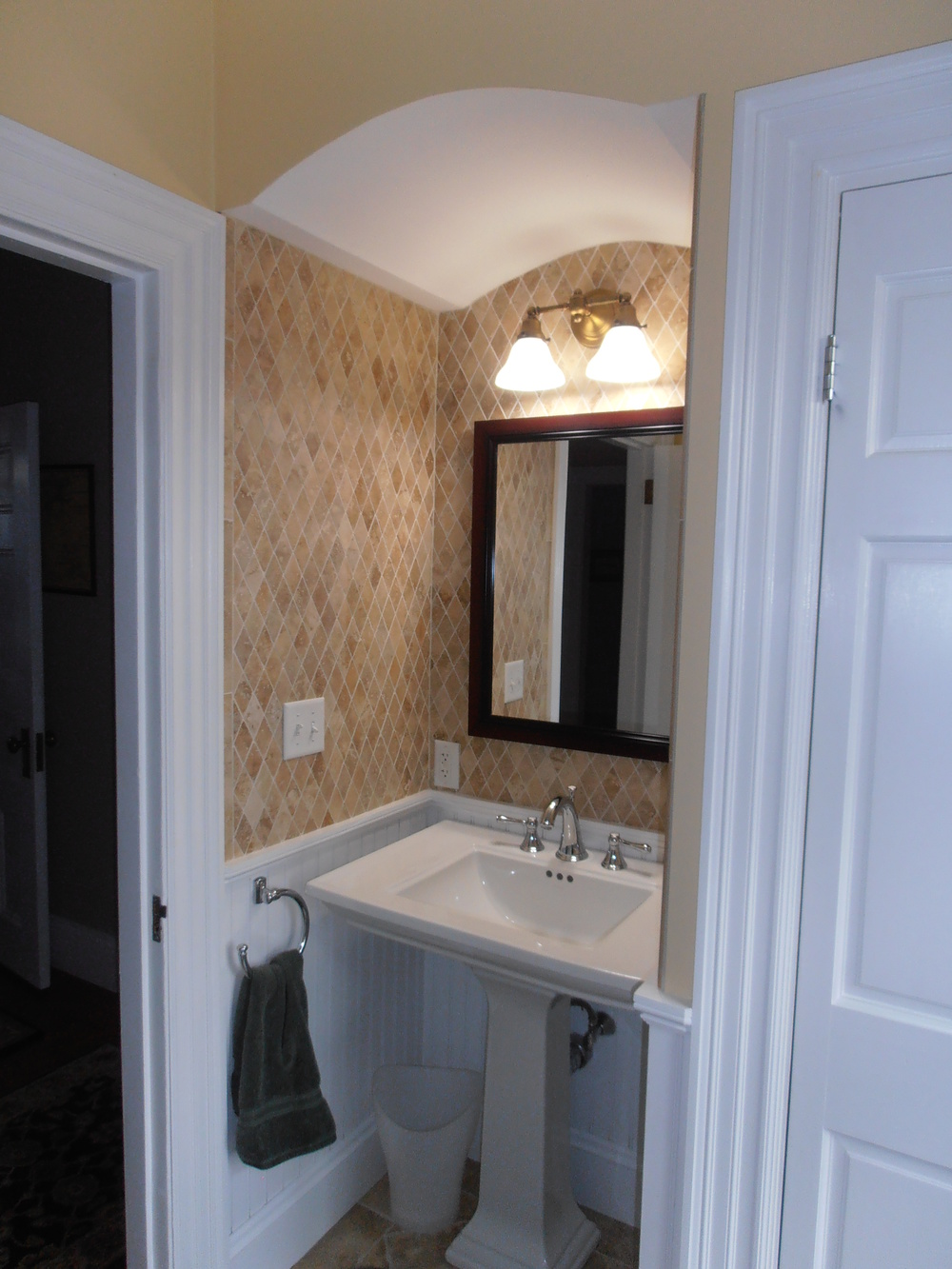 1 Pedestal Sink with Diamond Tiles and Arch.JPG