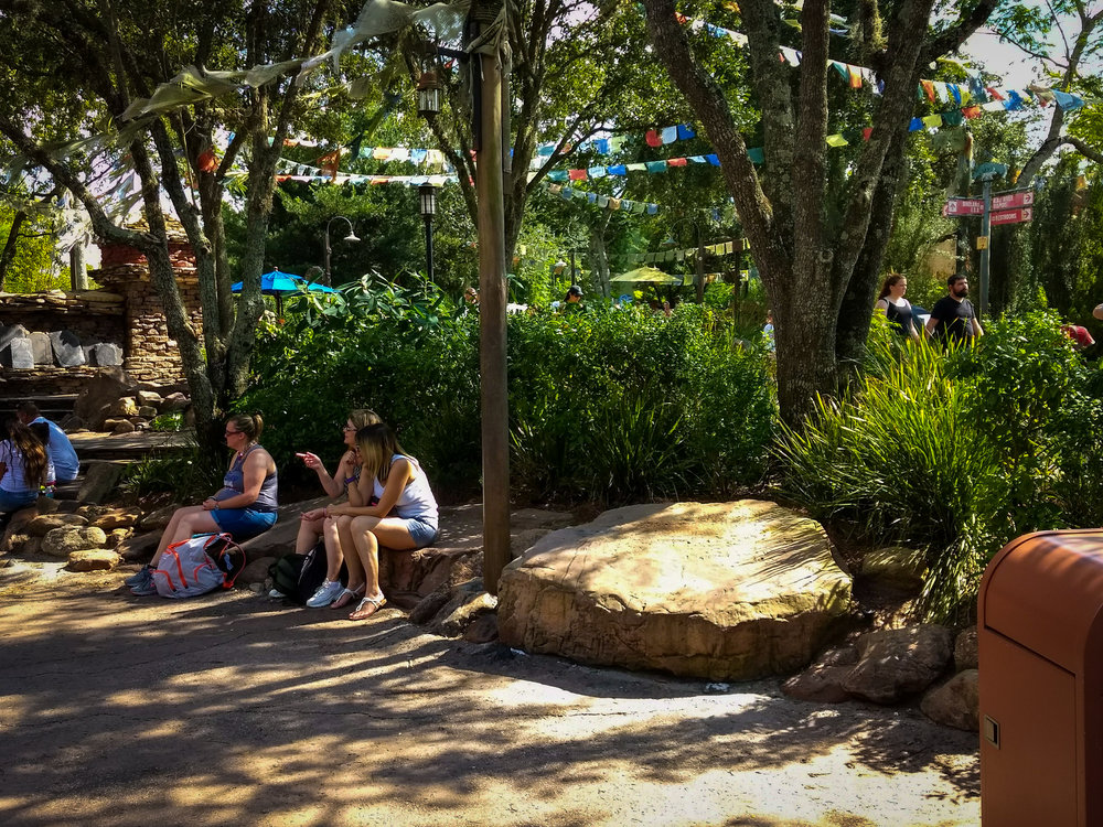 You might be surprised how many little resting places you find throughout WDW—benches, retaining walls, and the like.