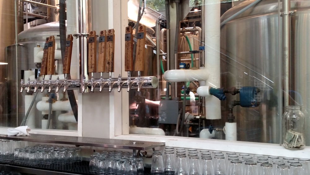 The taps, and a great view of the brewery behind