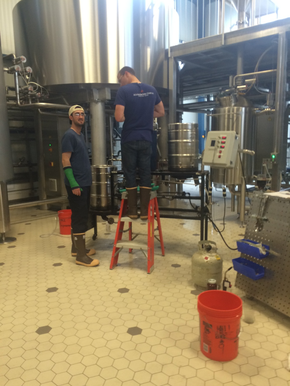 Allagash employees brewing a personal recipe on the pilot system