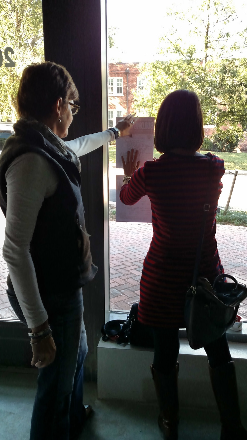 Hanging approved permits with our architect, Susan
