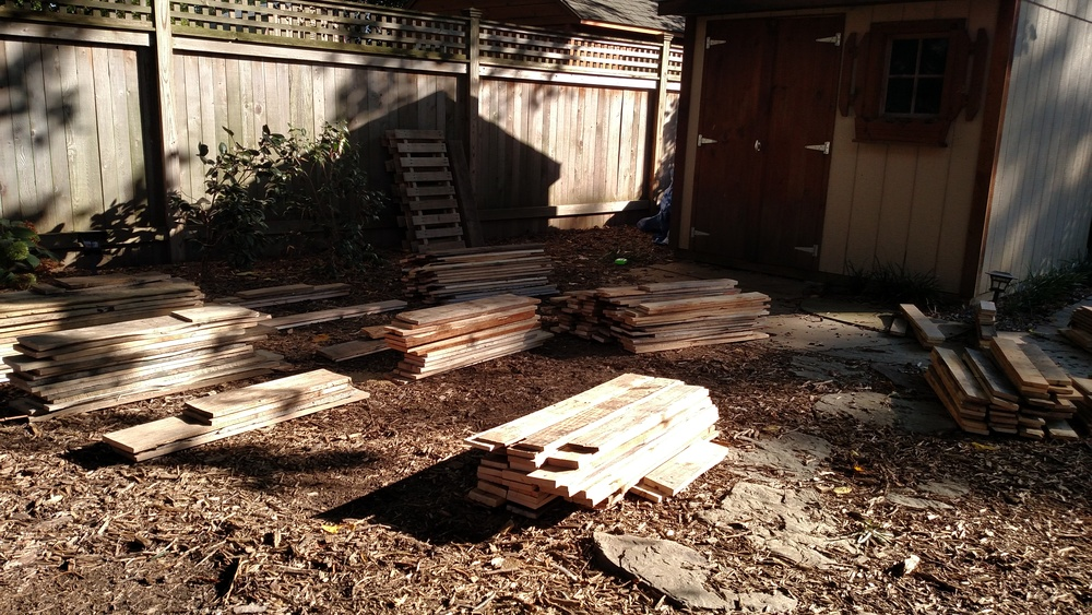 Organizing the pallet wood into piles by size